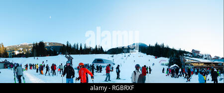 WHISTLER, BC, CANADA - JAN 14, 2019: A view of skiers coming down the hill as seen from Whistler village. - Stock Photo