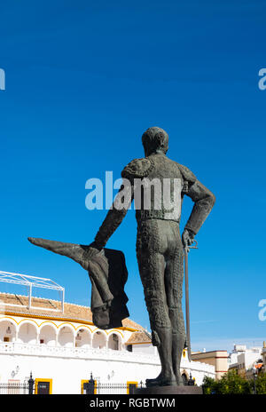 Statue of matador Pepe Luis Vazquez across from the Plaza de toros de la Real Maestranza de Caballería in Seville, Spain - Stock Photo