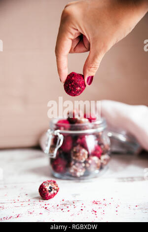Hand taking energy ball - Stock Photo