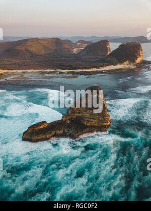 Indonesia, Lombok, Aerial view of rock formation near Kuta - Stock Photo
