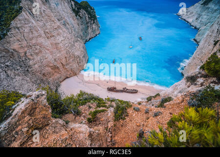 Navagio Shipwreck Beach on Zakynthos island, Greece. Famous attraction landmark must-see place visit the island of Zakynthos summer vacation - Stock Photo