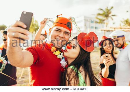 Brazilian Carnival. Couple in costume taking a self portrait - Stock Photo