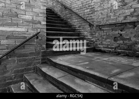 Two sets of outside steps at a right angle to each other, Saltaire, Yorkshire. - Stock Photo