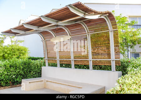 Bus stop on summer days without people, close-up - Stock Photo