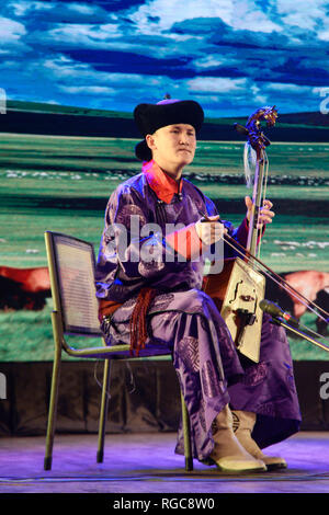 Kolkata, India. 28th Jan, 2019. Artist from China perform Chinese folk dance and music during the Happy Chinese New Year performance ahead of Chines New Year, schedule on February 05. Credit: Saikat Paul/Pacific Press/Alamy Live News - Stock Photo