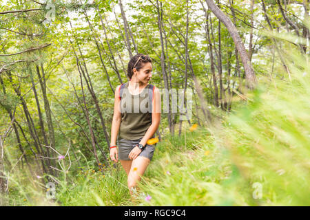 Italy, Massa, young woman hiking in the Alpi Apuane mountains - Stock Photo