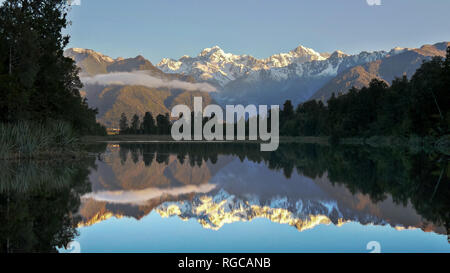 late afternoon shot of mt cook reflected in the waters of lake matheson in new zealand