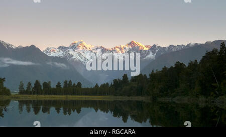 a shot of mt cook and lake matheson at sunset in new zealand