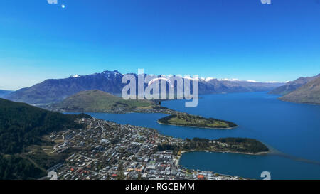 a paraglider takes off from skyline in queenstown, new zealand - Stock Photo