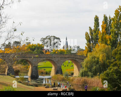 long shot of the historic old stone bridge in richmond, tasmania, the oldest bridge still being used in australia - Stock Photo