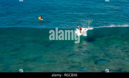 high angle view of a surfer riding a longboard at honolua bay, maui - Stock Photo