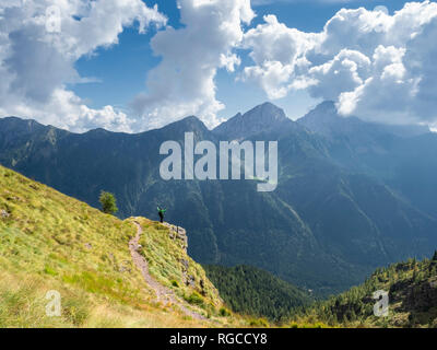 Italy, Lombardy, Valle di Scalve, hiker on hiking trail, Mount Camino - Stock Photo