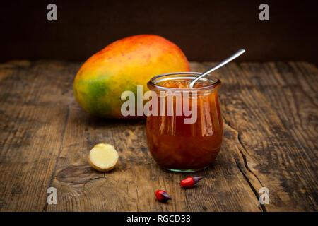 Glass of mango chutney with ginger and chili - Stock Photo