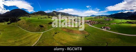 Germany, Bavaria, Swabia, Oberallgaeu, Obermaiselstein and Sonderdorf with fields - Stock Photo
