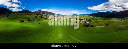 Germany, Bavaria, Swabia, Oberallgaeu, Obermaiselstein and Sonderdorf with fields - Stock Photo