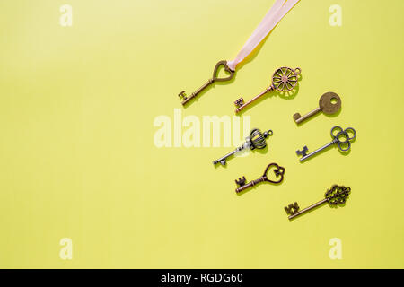 Collection vintage keys isolated . Top view.Antique keys flat lay pattern isolated on yellow background.Creative decorative background for design - Stock Photo