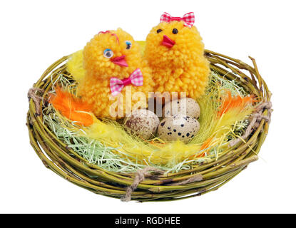 Easter handmade  nest from willow twigs with funny chickens and eggs isolated - Stock Photo