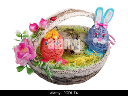 Easter handmade  nest from rope with funny chicken bunny  and eggs. Isolated on white studio macro shot - Stock Photo