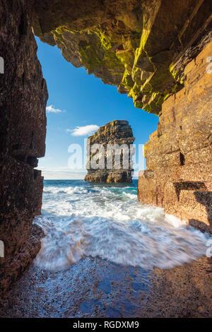 Dun Briste sea stack seen from a cave beneath Downpatrick Head. County Mayo, Ireland.