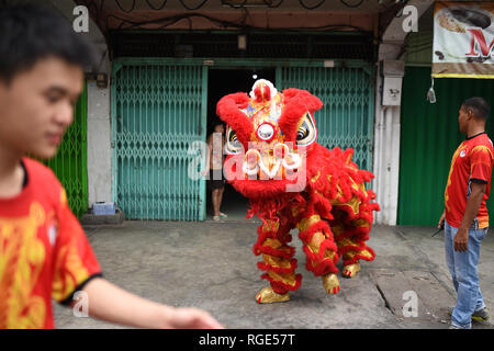 Banda Aceh, Indonesia - February 8, 2018: Chinese people celebrate Chinese New Year by playing dances in Chinese shops in the 'penayong' market - Stock Photo
