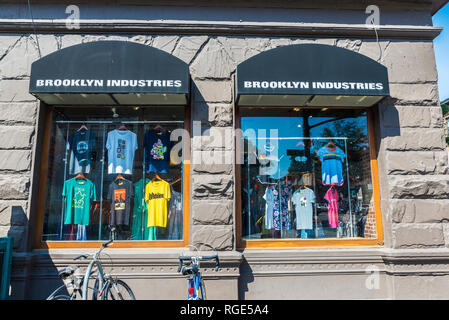 New York City, USA - July 26, 2018: Brooklyn industries store, designer t-shirt shop, in Brooklyn, Manhattan in New York City, USA - Stock Photo
