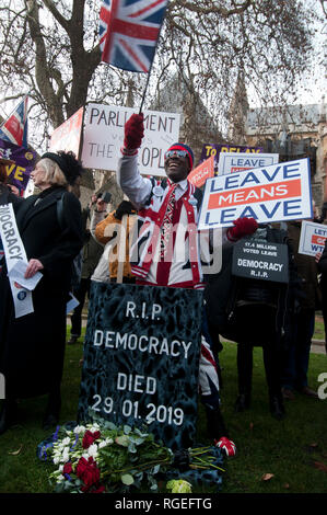 Westminster, London. January 29th 2019. Demonstrators, for and against Brexit, outside Houses of Parliament as amendments to the European withdrawal agreement are voted on. Women dressed as suffragettes protest that democratic vote is not being observed and take part in a mock funeral procession. Credit: Jenny Matthews/Alamy Live News - Stock Photo
