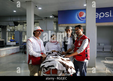Sanaa, Yemen. 29th Jan, 2019. Staff members of the Yemeni Red Crescent stand next to released Saudi prisoner Moussa al-Awaji (2-L) as he waits to board an aircraft of the International Committee of the Red Cross (ICRC), after being freed by the Houthi rebels, at Sanaa's International Airport. Credit: Hani Al-Ansi/dpa/Alamy Live News - Stock Photo