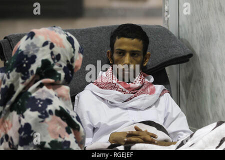 Sanaa, Yemen. 29th Jan, 2019. Released Saudi prisoner Moussa al-Awaji (R) waits to board an aircraft of the International Committee of the Red Cross (ICRC), after being freed by the Houthi rebels, at Sanaa's International Airport. Credit: Hani Al-Ansi/dpa/Alamy Live News - Stock Photo