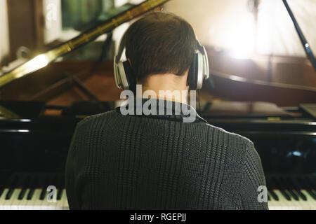 musician working on recording studio piano, sax, double bass, drum - Stock Photo