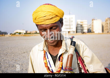 Chit Chat with Snake Charmer and Captured his Beautiful Images at Sea view Clifton Beach Karachi - Stock Photo