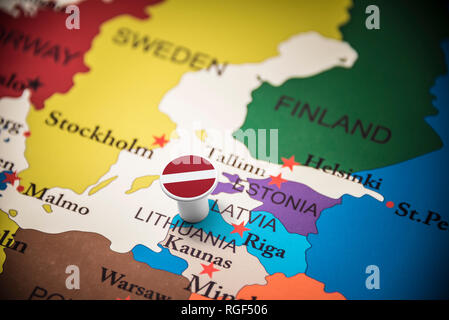 Latvia marked with a flag on the map - Stock Photo