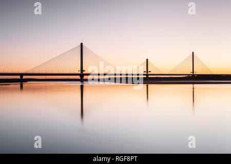 Sunrise view of the Mersey Gateway Bridge over the River Mersey that connects Runcorn and Widnes in Cheshire - Stock Photo