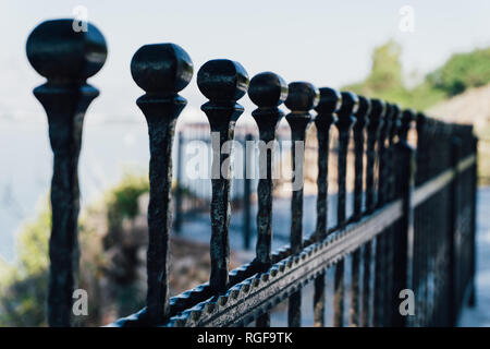 Black metal fence. Close perspective. - Stock Photo
