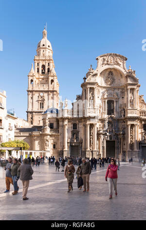 People walking in the Plaza del Cardenal Belluga before Murcia cathedral, Spain, Europe - Stock Photo