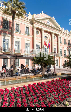 People sitting outside at the Tornasol cafe bar before the Town Hall or Casa Consistorial in Murcia, Spain, Europe - Stock Photo