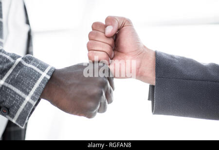 close up.two businessmen give each other a fist - Stock Photo