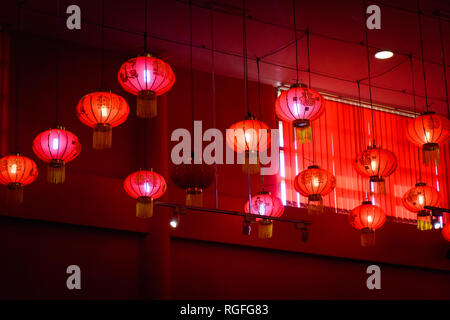 Decorating hanging Chinese lantern lamps on the ceiling. - Stock Photo