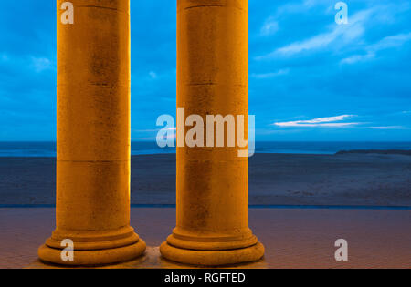 Two doric columns of the Venitian Gallery by the Waterfront of Ostend city, the North Sea Beach and waterfront, Belgium. - Stock Photo