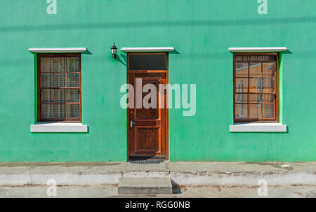 Vintage green turquoise facade in the Malay district of Bo Kaap in Cape Town, South Africa. - Stock Photo