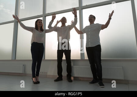 young business team standing in a bright office