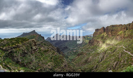 Iconic Teno mountains with curved mountain road - Stock Photo