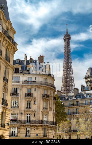 Elegant apartment buildings on Rue Edmond Valentin with the Eiffel Tower towering above ,Paris ,France - Stock Photo