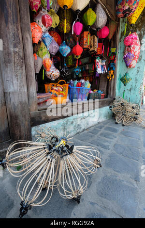 Traditional colorful paper lanterns hanging for sale at a shop in old town Hoi An, Vietnam, Southeast Asia - Stock Photo