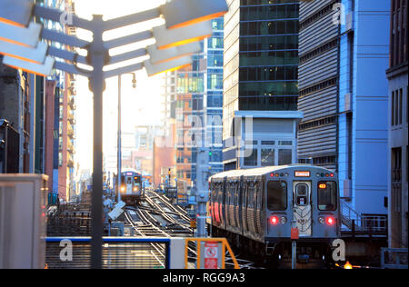Chicago 'L' trains running on elevated railroad tracks near State/Lake station in the Loop of Chicago. Illinois.USA - Stock Photo