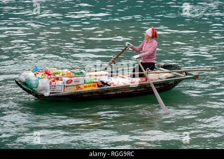 Woman selling products from a boat on Halong Bay, Vietnam, Asia - Stock Photo