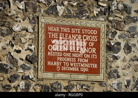 Plaque on clock tower at St Albans commemorating a former Eleanor Cross - Stock Photo