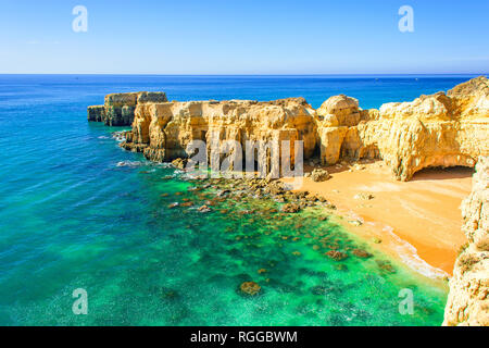 beautiful sea view with secret sandy beach among rocks and cliffs near Albufeira in Algarve, Portugal - Stock Photo