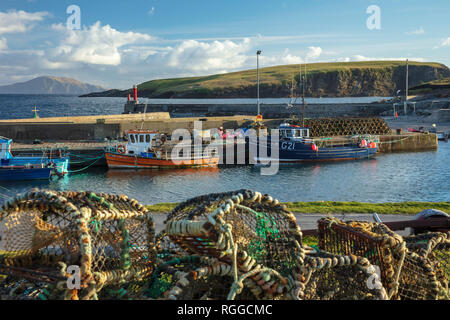 Fishing Boats and lobster pots at Purteen Harbour, Achill Island, County Mayo, Ireland. - Stock Photo