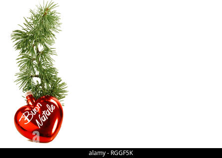 Merry Christmas written with heart and pine sprig on a white background - Stock Photo