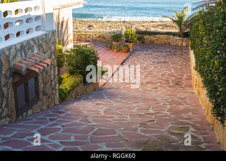 Sea, travel and vacation concept - Path to the beach in summer - Stock Photo